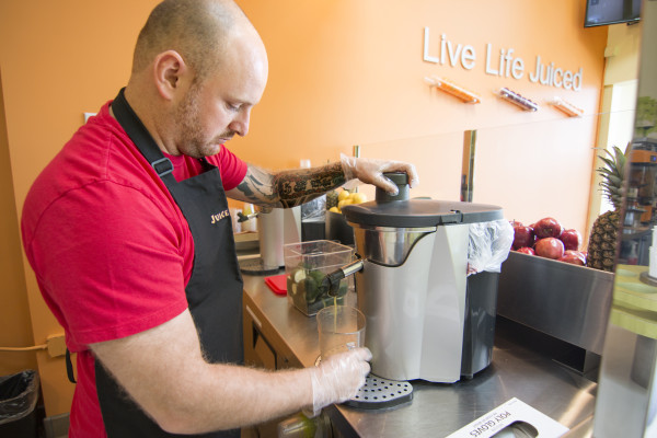 Vincent Rodgers, owner of Juice It Up in Hermosa Beach, makes one of the store's popular vegetable-based juices. Photo