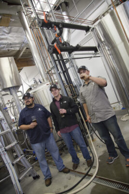 King Harbor Brewing Company owners Paul McDaniel, Will Daines and Tom Dunbabin in their brewing facility. King Harbor Brewing celebrates its first anniversary on Saturday, April 11. Courtesy photo.