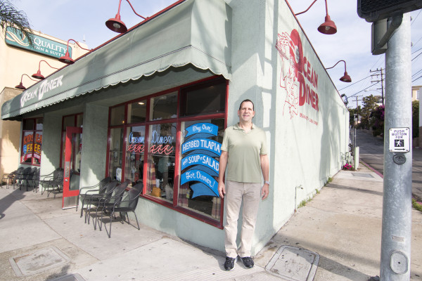 Owner Rick Hankus at the corner of yummy (Aviation Blvd.) and delicious (Ocean Drive) . Photo by Brad Jacobson