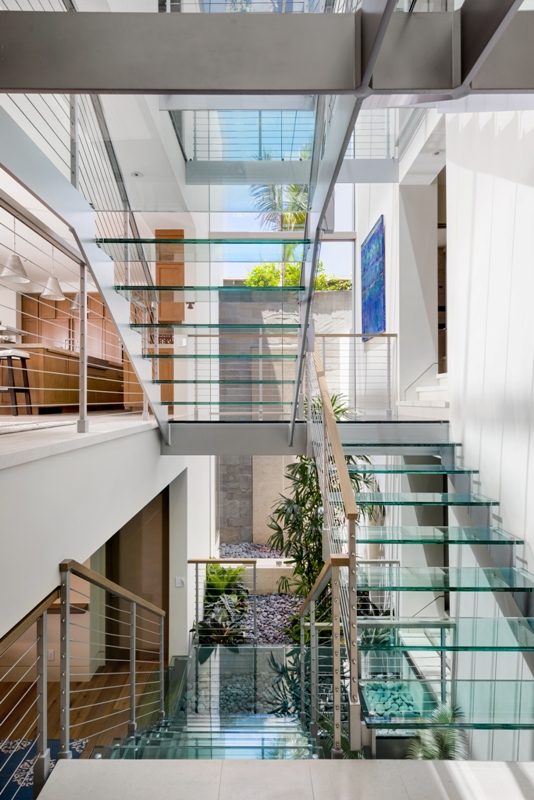 Visitors to the Lopez home encounter a three-story glass stairway in the entryway.