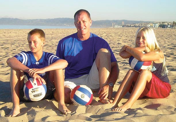 American Martyr's new athletic director Denny Lennon, shown with son Vaun and daughter Ciena, is also the director of the AAU National Junior Beach Volleyball National Championship held each summer in Hermosa Beach. Photo by Randy Angel