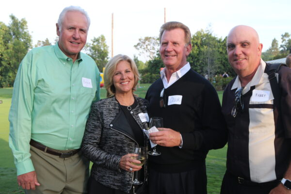 Margarita and Chuck Lande (center) of the Chadmar Group home builders and Rolling Hills Country Club trustees Bruce Steckel and Kerry Welsh at last week's announcement of the new course. Photo by Kevin Cody