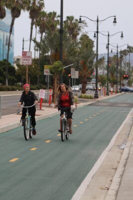 Two cyclists ride down the new bike path along Harbor Drive. The grand opening for the Harbor/Herondo Gateway project is June 13. Photo by David Mendez