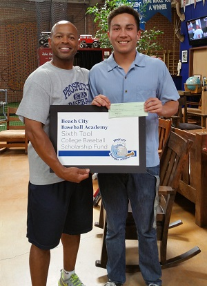 Coach Kenny Woods presents Hunter Lewis with the Sixth Tool Scholarship Award. Woods first coached Lewis as an 11-year-old. Photo courtesy of Beach City Baseball Academy