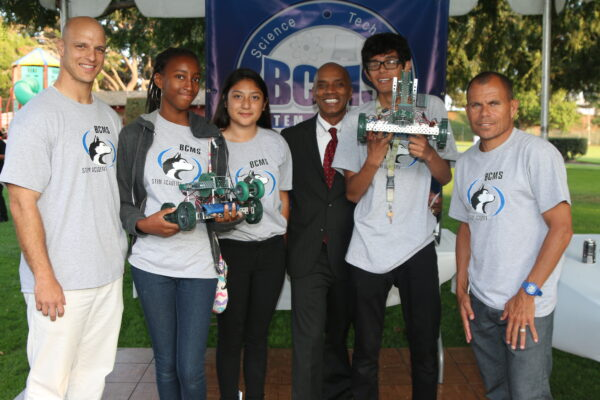 Bud Carson Middle School assistant principal Josh Godin, students Alexis Baley, Yenitzie Amacho, trustee Alexandre Monteiro, Joshua Baca, and principal Mark Silva. Photo by Kevin Cody