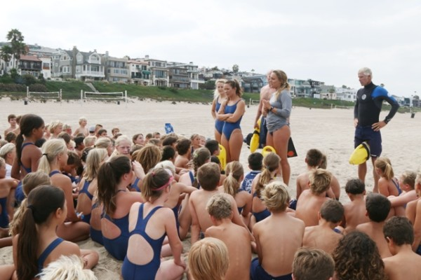 El Segundo and Manhattan Beach Junior Lifeguards get instructions on their joint meet. Photo by Kevin Cody