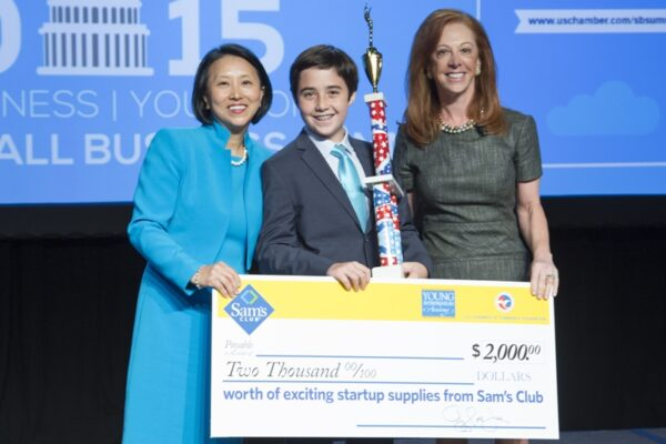Lane Karlitz recieves a $2,000 Sams Club card, plus a $24,000 scholarship for his second-place fiish at the Young Entrepreneurs Academy contest in Washington, DC, USA - June 9, 2015: 2015 America's Small Business Summit.    Photo by Ian Wagreich / © U.S. Chamber of Commerce