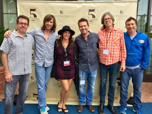 Adam Spriggs and his wife, Carrie, with Rhett Miller and the Old 97s. Photo courtesy Madison Entertainment