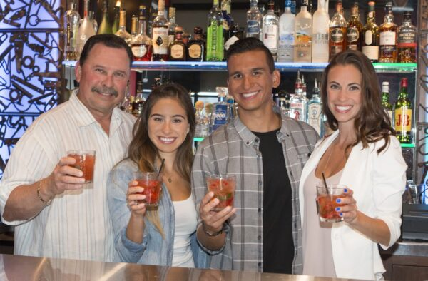 Avenue A co-owner Marty Rodriguez with his daughter Brittany and customers Juan Hernandez and Amy Frena. Photo by Brad Jacobson.