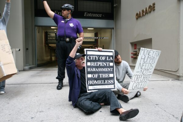 Jeff Dietrich and Jeremy Miller protest in June against the Central City Association's policies against homeless folks. Photo by Mike Wisniewski
