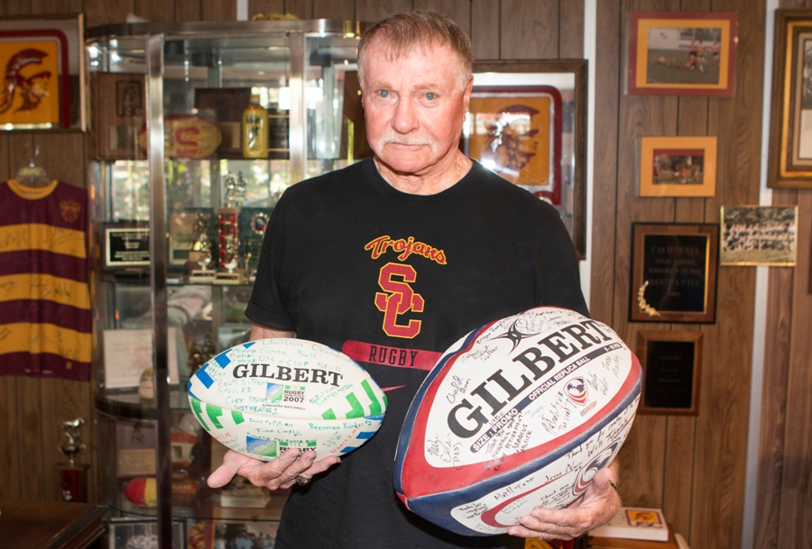 USC Rugby Hall of Famer Dave Lytle with a team ball and the 2007 Rugby World Cup Championship Ball. His team went undefeated that year. Photo by Brad Jacobson (CivicCouch.com)