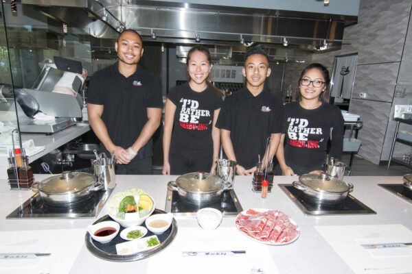 """Diners at King Shabu Shabu cook their own food in a steaming broth -- a method called """"shabu-ing"""" -- but staff is nearby to provide assistance. Photo by Brad Jacobson"""
