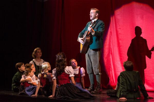Ben Davis as Captain von Trapp, with Kerstin Anderson as Maria Rainer and the von Trapp children. Photo by Matthew Murphy