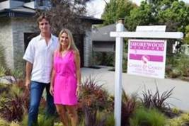 Realtors David and Jennifer Caskey changed their signs to pink this month in support of Breast Cancer Awareness.