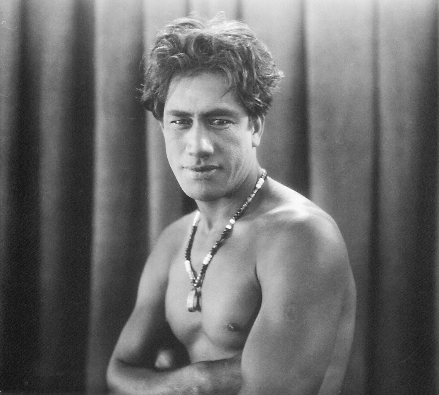 A portrait of Duke Kahanamoku taken for use in Hollywood studios. Photo by The Paragon Agency.