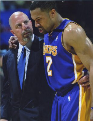 Vitti helping Derek Fisher off the court. Fisher, now the New York Knicks head coach, won five titles and ensured his place in Lakers history with his walk-off game winning shot with .04 seconds left against the Spurs in the 2004 playoffs. Courtesy Gary Vitti collection