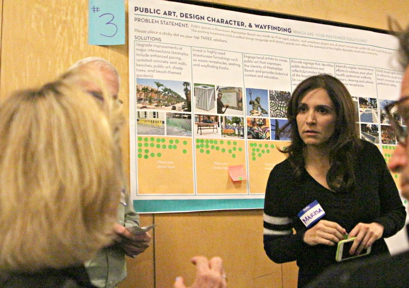 Community Development Director Marisa Lundstedt answers a question at a workshop on the future of downtown. Photo by Caroline Anderson