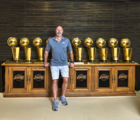 Los Angeles Lakers trainer Gary Vitti with the club's champion trophies. Vitti was a part of eight championships. Photo by Pete Henze