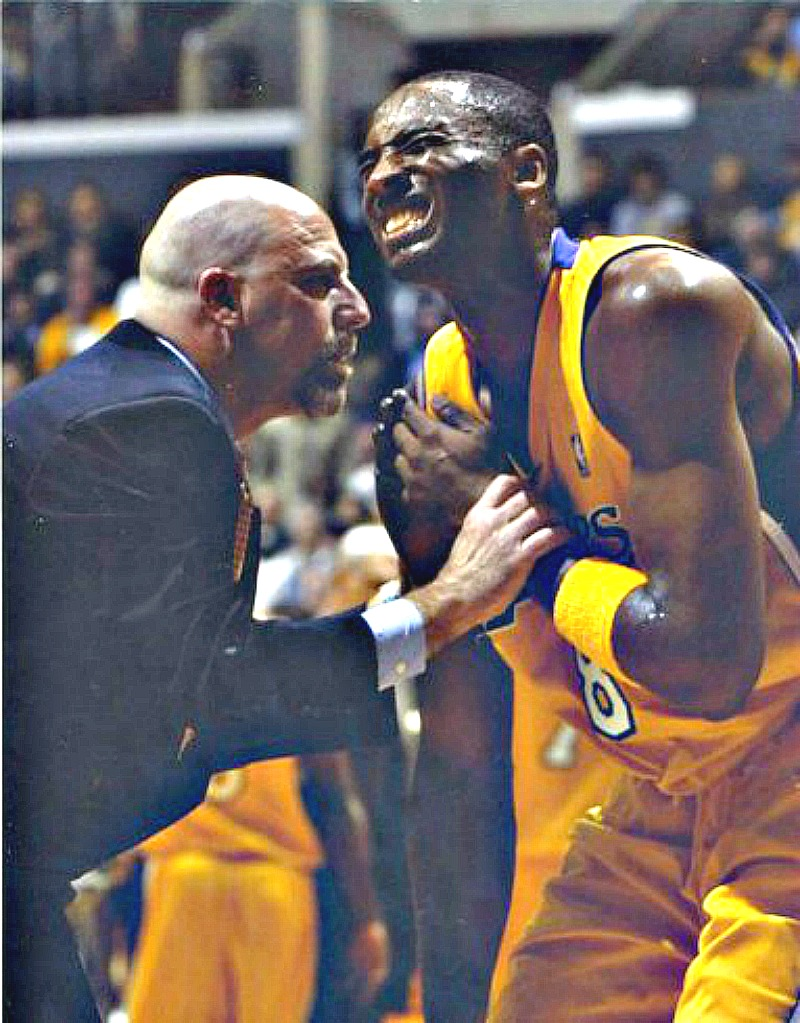 "Vitti working on Kobe Bryant's injured hand. ""Kobe is a basketball warrior,"" Vitti said. ""At times it seemed like he could play through any injury."" Courtesy Gary Vitti collection"