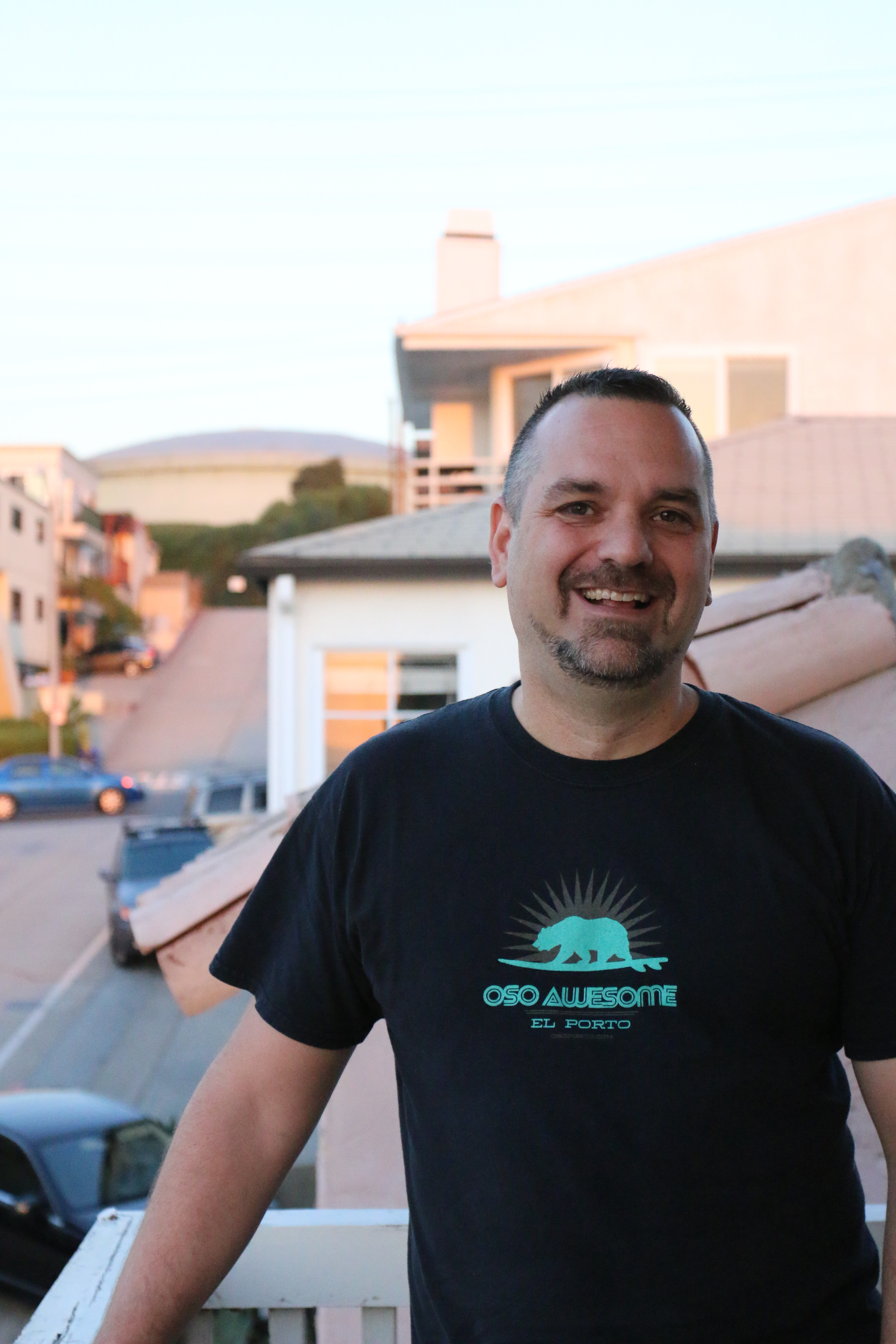 Jon Berry outside his El Porto apartment, wearing a t-shirt from his brand Osoporto. Photo by Caroline Anderson