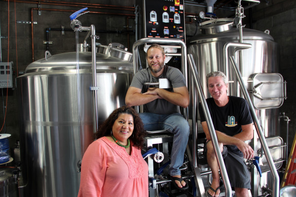 The Hop Saint Brewing Company has opened, and its storied crew includes front of house manager Christina Oliva, brewmaster Brian Brewer (yes that is his real name), and head of operations Steven Roberts (the legendary Boogaloo man). Photo by Kathleen Fisher