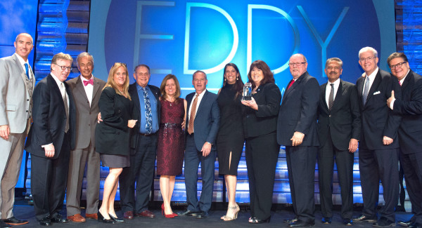 Mayor Suzanne Fuentes, accompanied by city staff, city council members, and local business leaders, accepts the Most Business Friendly City award from the Los Angeles County Economic Development Corporation. Photo courtesy LAEDC