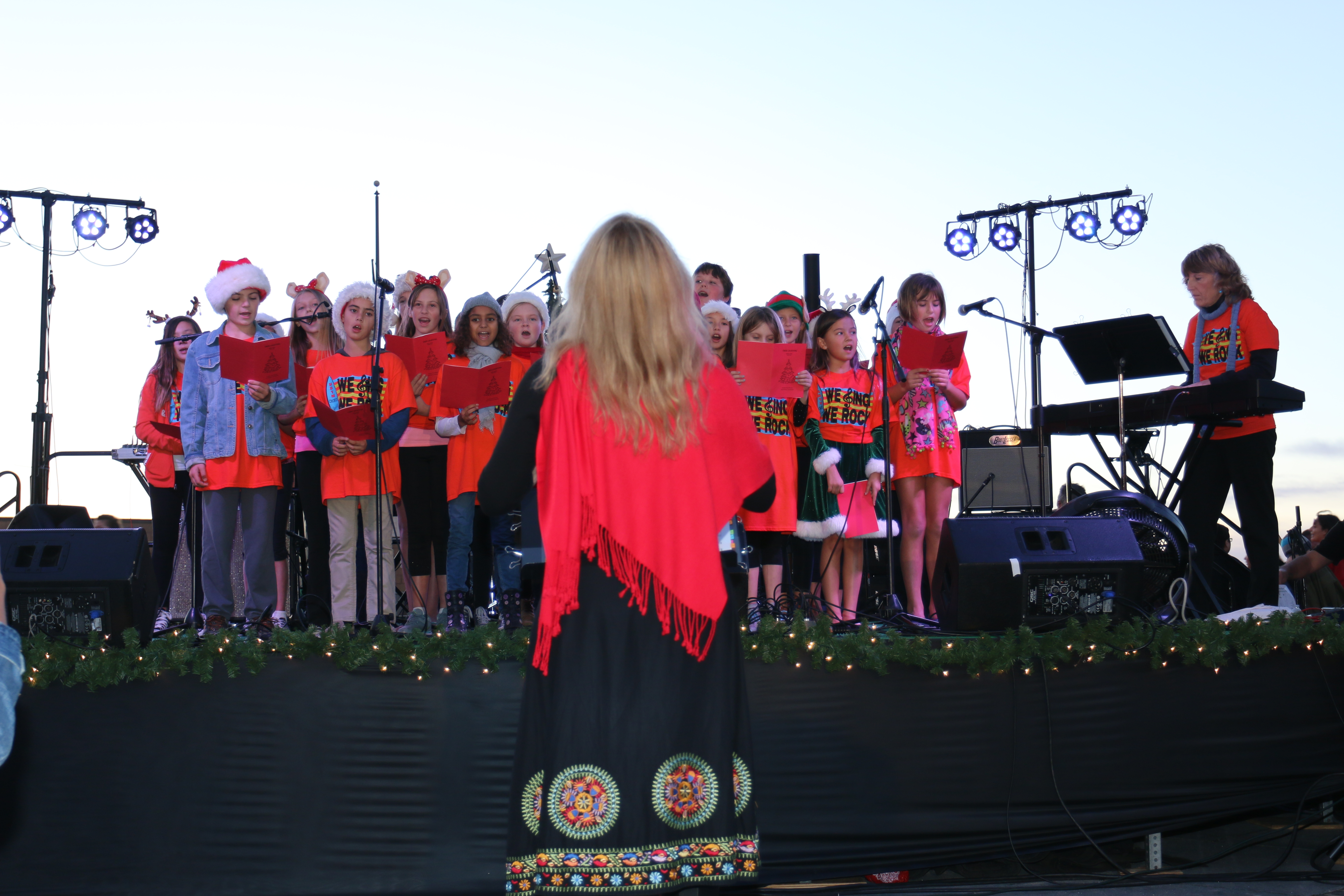 "Choral director Candace Ford and accompanist Karla Devine leads the Hermosa Beach Youth Music Chorus in a rendition of ""Feliz Navidad"" at the Hermosa Pier Tree Lighting Ceremony last Thursday. Photo by Ryan McDonald"