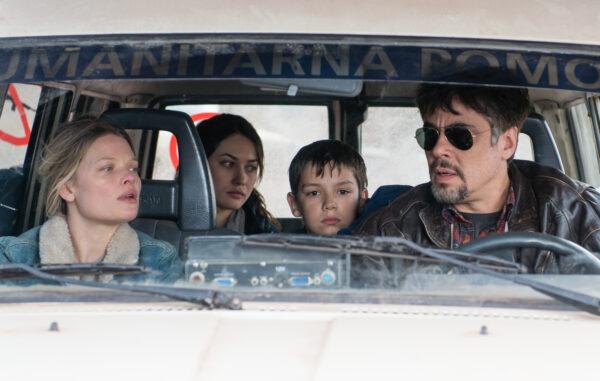 Mélanie Thierry (Sophie), Olga Kurylenko (Katya), Eldar Residovic (Nikola) and Benicio del Toro (Mambrú) in Fernando León de Aranoa's A PERFECT DAY. Courtesy of Fernando Marrero. © REPOSADO P.C. and MEDIAPRODUCCIÓN S.L.U. An IFC Films release.
