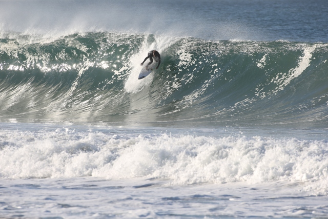 Thank goodness local surfer Noah Collins is a pro. With drops like this, surfboards tend to snap. Photo by Mike Balzer