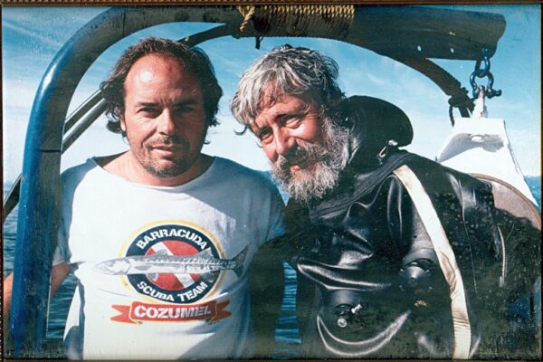 Eddie Paul with Jean Michel Cousteau. Paul built sharks and worked on underwater photography with Cousteau for seven years.