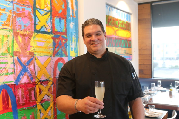 Chef Orlando Mulé, with artwork by his wife, the artist Carole Beauvais, opened Orlando's Pizzeria & Birreria shortly after arriving in Redondo Beach from Montreal. Photo by Mark McDermott