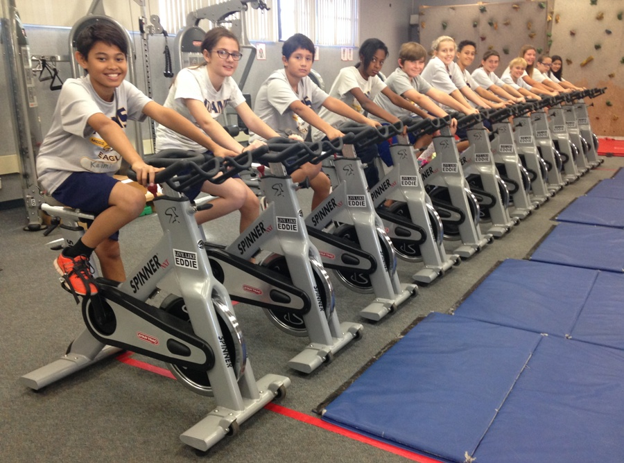 Adams Middle School students get a cardio workout on spin bikes donated by  the family of