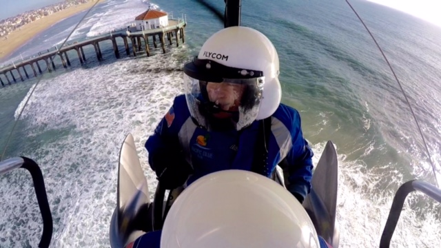 Manhattan Beach City Councilmember Wayne Powell flying an ultralight by the pier. Photo by Henry Boger