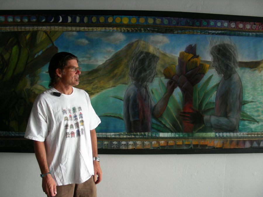 Steve Shriver with his work shown at Zask Gallery in 2009, part of a series in honor of the death of his best friend in a surfing accident. Photo courtesy of Peggy Zask