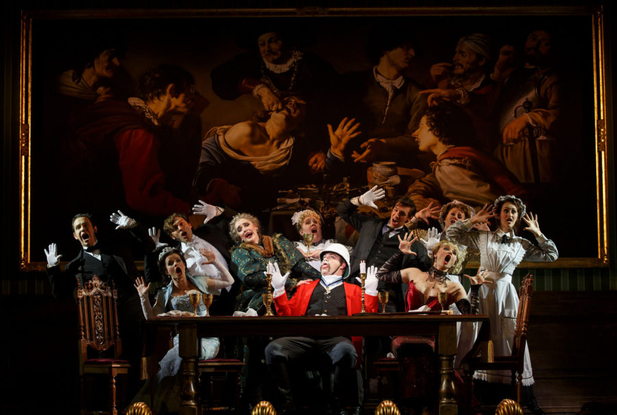 The cast with John Rapson as Lord Adalbert D''Ysquith (in bright red). Photo by Joan Marcus