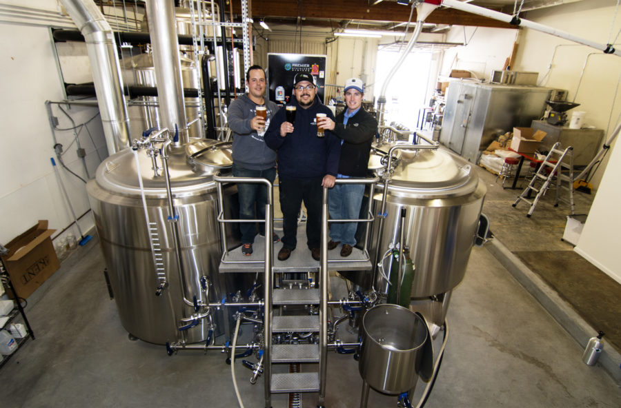 King Harbor Brewing's Tom Dunbabin, Paul McDaniel, Will Daines in their brewing facility.