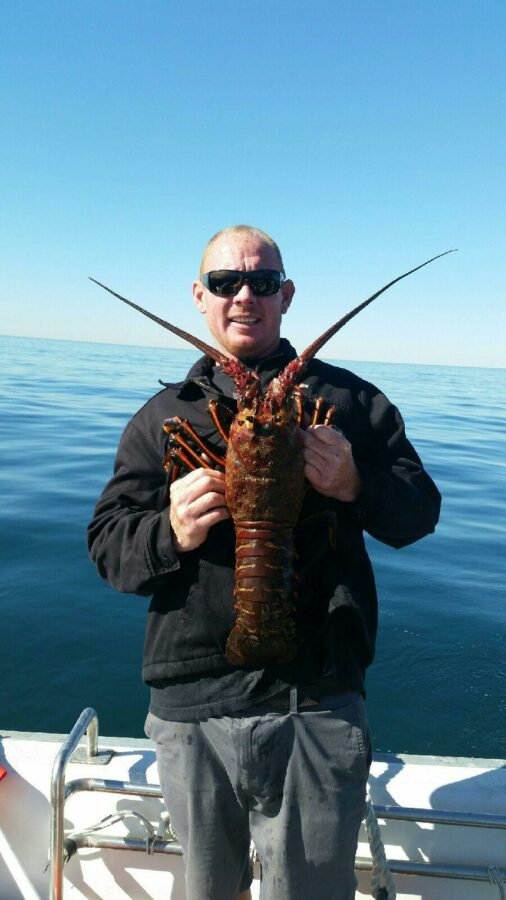 Taras Poznik with a legal lobster, times two. Photo curtesy of Matt Meistrell.