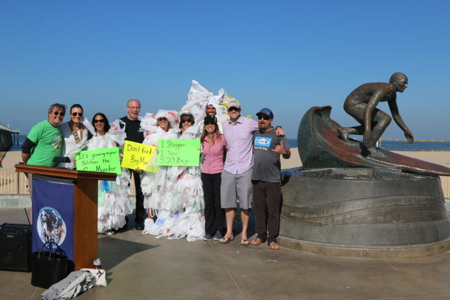 "Residents and city officials gather with a quartet of ""Bag Monsters"" at the Hermosa Pier last Friday, as the city kicked off Earth Month with the beginning of its plastic bag ban. Photo by Ryan McDonald"