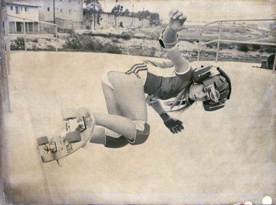 Whitehead takes in some tunes as she negotiates the terrain at Skateboard World in Torrance. Photo courtesy Cindy Whitehead