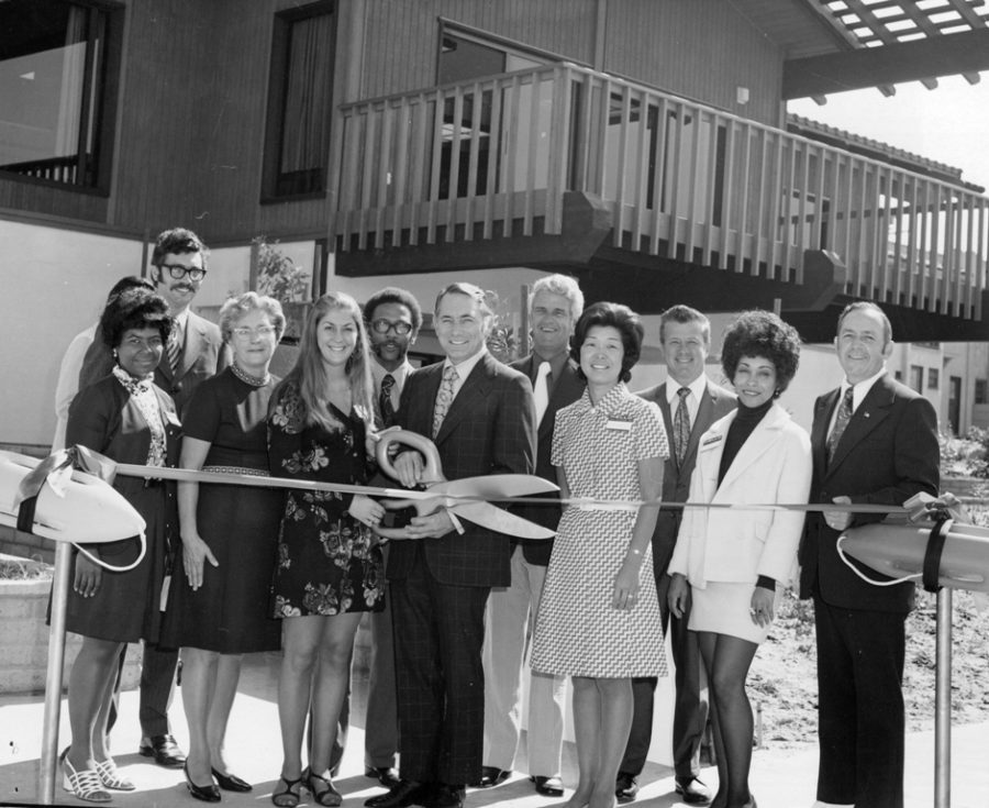 Assistant Director of the Department of Beaches Jerry Cunningham (in white tie), next to Supervisor Burton Chase at the Headquarter dedication in Manhattan Beach. Director Dick Fitzgerald is at far left.