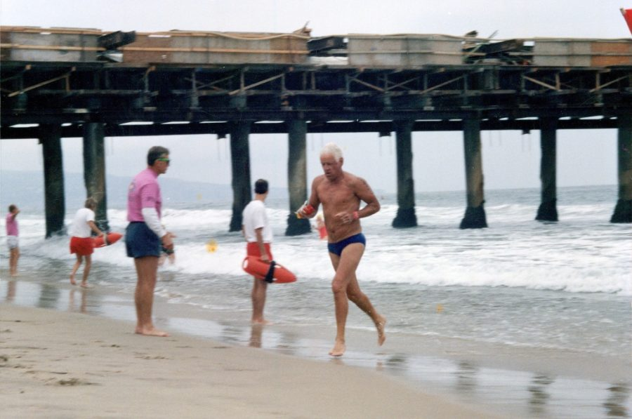Jerry Cunningham completing the Two Mile Dwight Crum Pier to Pier Swim in 20015, at age 76.
