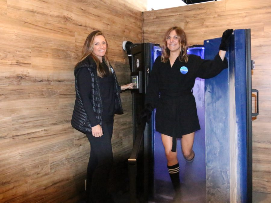 Cryo Wave employee Chelsea stands in the doorway of the cryo sauna as it's operated by owner Paige Sullivan. Photo