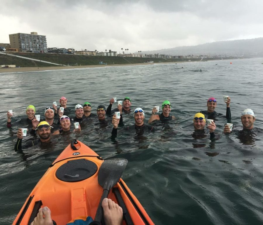 The Saturday morning swim group led by Mineo takes a coffee break. Photo by Chris Tallman