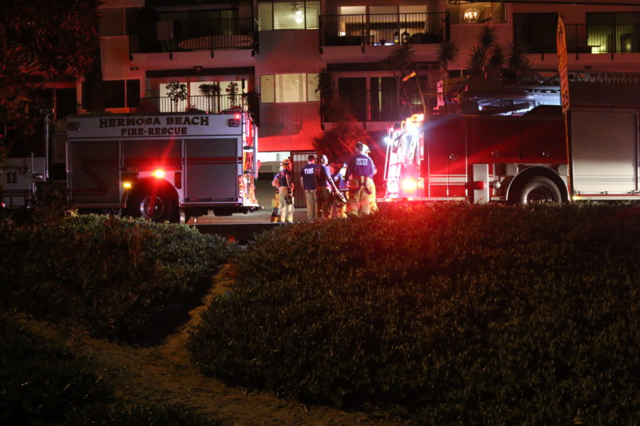 Firefighters outside the Apple Tree Apartments Monday night. Photo by Ryan McDonald