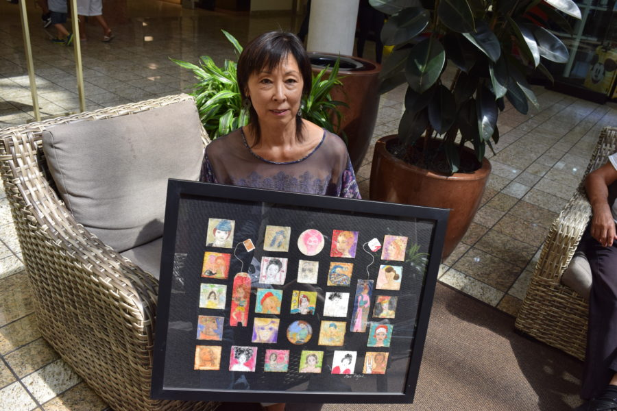 Irene Rafael with some of her painted tea bags. Photo by Bondo Wyszpolski