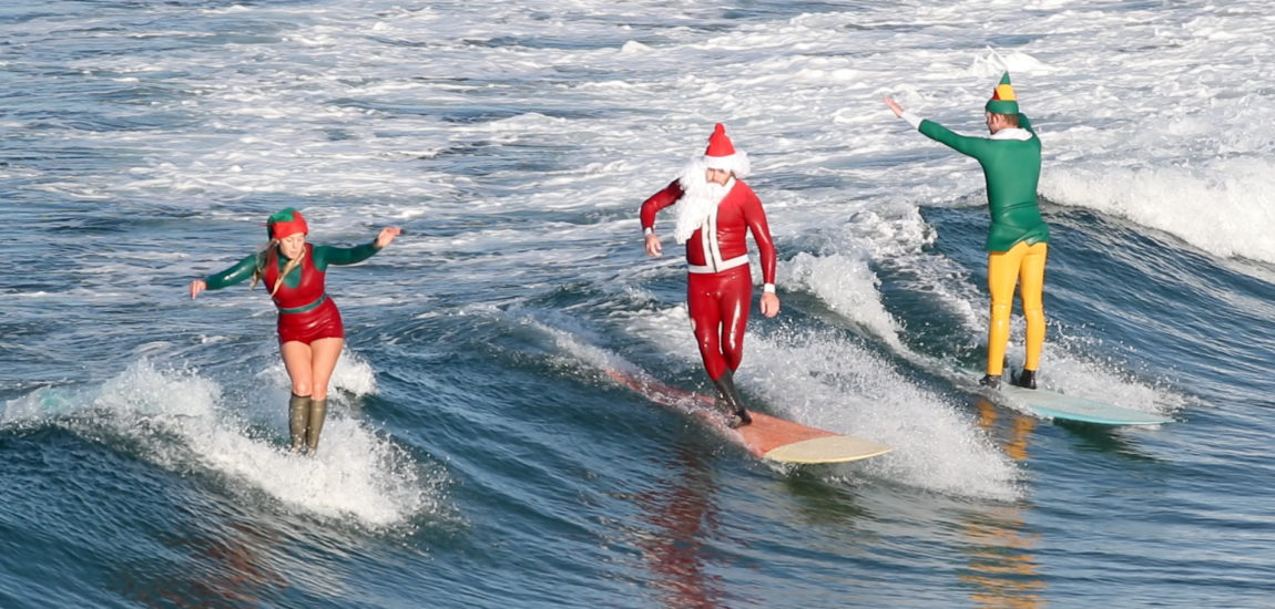 Santa and his elves take a much needed break to go surfing in Manhattan Beach (Video)