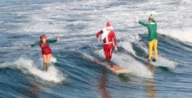 Santa and his elves take a much needed break to go surfing in Manhattan Beach (Video)