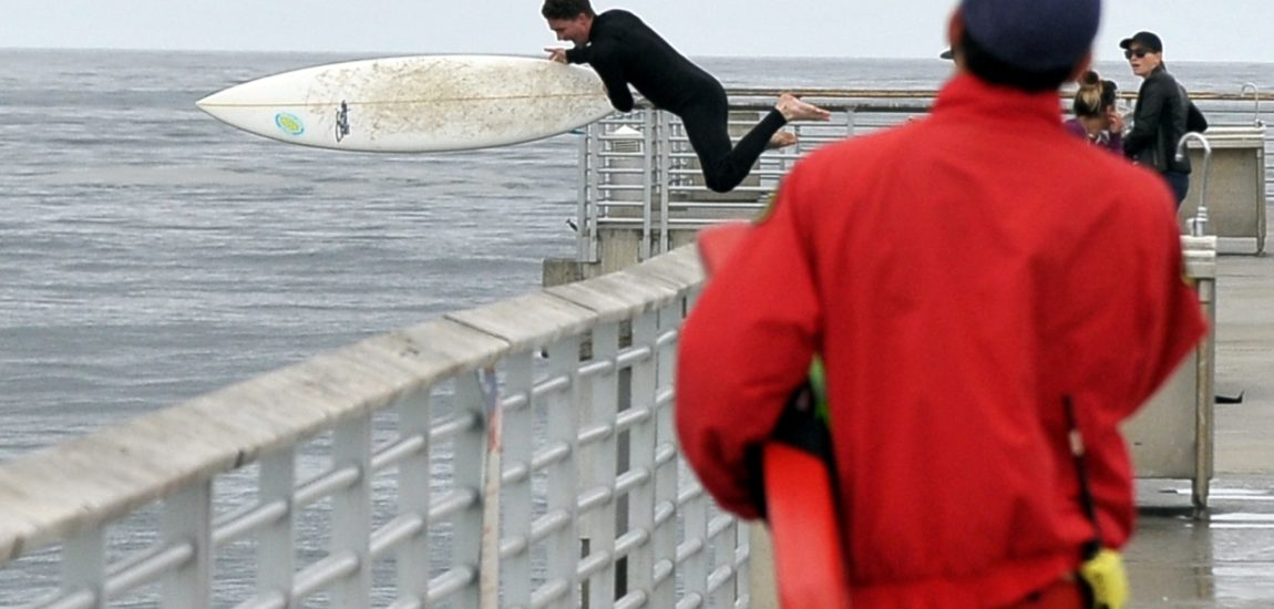 Hermosa Beach Pier jumper ticketed after catching big wave [Updated]