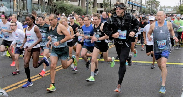 Rain fails to dampen runners spirit in annual Super Bowl 10K/5K races