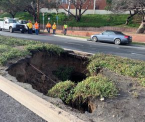 Sinkhole caves in median and stretches under road along Artesia Boulevard
